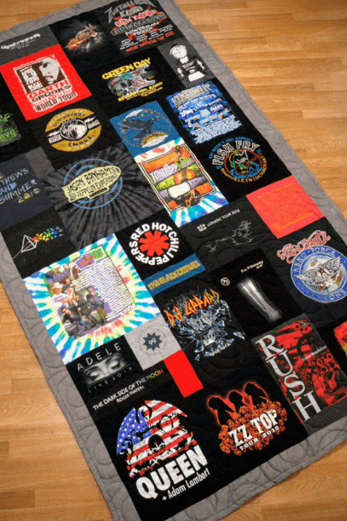 A quilt made from t-shirts in a collage pattern